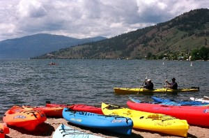 Kayaks Along Kin Beach with Adventure Bay in Background